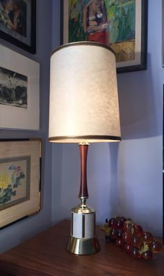 A personal favorite from my Etsy shop https://www.etsy.com/listing/287407161/mid-century-brass-and-wood-table-lamp