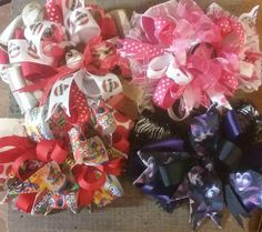"""SALE  Lot of 4 different over the top hair bows in assorted colors.   Bows range in size from 4-5"""" and are attached to alligator clips by SweetDesignsbyCindy on Etsy"""