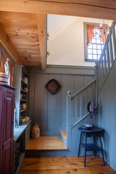 A Rear Stair, located at the back of one of our Ells, with storage space underneath. www.earlynewenglandhomes.com