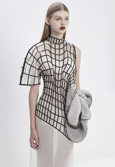 Conceptual fashion design with graphic patterns & 3D-printed shapes based on distorted digital.
