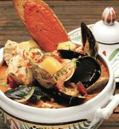 Celebrate Julia Child's birthday with Bouillabaisse - It is the quintessential dish from Marseilles that Julia and her husband Paul grew to love while living there. Try making it at home. #JC100