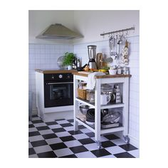 STENSTORP Kitchen cart  - IKEA  Maybe more of a fit with the style of the apt?