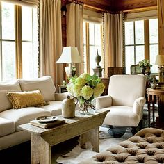 Linen curtains with vintage trim add elegance to this rustic living room.