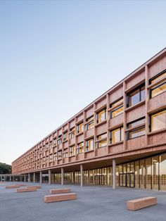 The College in Lamballe is mainly constructed in timber. It consists of two separate buildings: a long rectilinear parallelepiped rests on a gently curved base, to echo the site's topography and fit in with the landscape. Fully glazed, the ground floor brings a sense of lightness to the building. #architecture #education #school #building #glass #timber #france University Architecture, Building Architecture, Simone Veil, Ground Floor, Facade, Multi Story Building, College, Construction, France