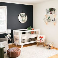 Dare to be bold with your #nursery styling choices! We love how @meganynichols included a dark accent wall in her little one's space. Recreate this look at the link in our profile. #mymodern #nurseryinspo