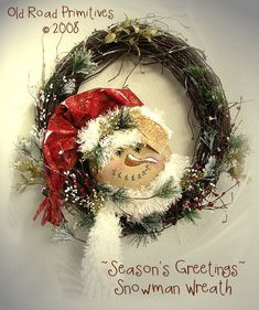This darling snowman wreath is a new design by Old Road Primitives for Christmas 08! You are going to love this Snowman Wreath! It has a little