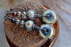 Black moon tribal gritty rustic earrings / Fossilized black & yellow lampwork / Red tiger eye / Dark night sky inspired / Total Sun Eclipse