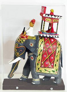 King Sitting on Royal Elephant with Mahut (Encased in a Acrylic Box) -Kondapalli Doll  (Wood))