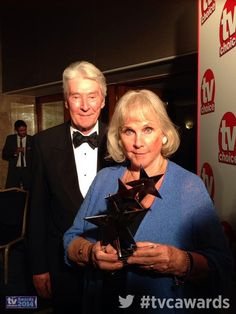 TV CHOICE AWARDS [UK] (September 8, 2014) ~ Benedict Cumberbatch wins Best Actor for SHERLOCK (BBC). He's at the Toronto International Film Festival for THE IMITATION GAME screening, so his parents, actors Timothy Carlton & Wanda Ventham (who also play his parents on SHERLOCK) accept his award for him.