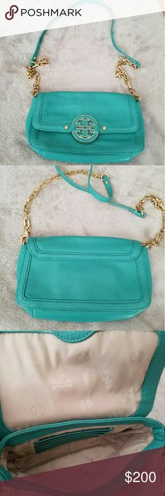 Tory Burch Amanda mini cross-body in teal Gently used purse in good used condition. It does have a few normal wear flaws. Last picture shows a minor stain. I'm sure it can be removed. Also the emblem in the front has a bit of discoloration please ask for pictures. Inside there is a tiny stain also should be able to be removed. The strap also has a blemish like the last picture. This color is no longer available online or in stores. Tory Burch Bags Crossbody Bags