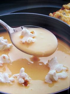 Beer Cheese Soup, garnished with popcorn.