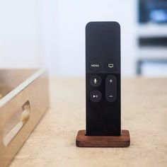 The AppleTV Remote Stand by @studioneat is milled from a piece of solid walnut and finished by hand with tung oil. The stand is small enough to go unnoticed in your living room yet the quality is evident upon close inspection. #startups #gadgets #tech