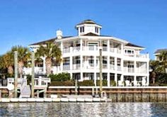 5+ bedrooms, incredible, unspoiled sunset views, pier, 2 boat lifts. Open floor plan all on a private island. Buzzy - 910-520-0990