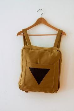 This gives me an idea: i shuld make a backpack where it will look like i have the triforce shield from zelda on my back! nerd.