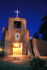 The San Miguel Mission is considered the oldest Church in the country. The simple Spanish Colonial architecture creates a truly majestic silhouette against the bright blue Santa Fe New Mexico sky.