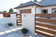 Ogrodzenie z betonu architektonicznego (do LUXUM) House Fence Design, Modern Fence Design, Door Gate Design, Front Yard Fence, Front Yard Landscaping, Outdoor Glider, Garden Retaining Wall, Brick Design, Backyard Fences