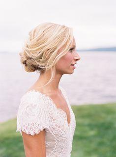 Bridal Updo, Low Bun Hairstyle | Photo: Tec Petaja. View More:  http://www.insideweddings.com/weddings/childhood-friends-celebrate-wedding-at-marriott-familys-lake-house/866/