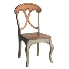Love. This. Chair. It's rustic and civilized at the same time. With a mahogany-clad back and seat and sage green legs, it's the perfect choice to mix and match for a Euro-chic flair.   $149.95 at Pier 1