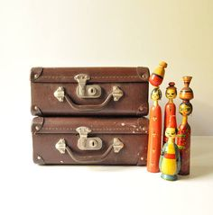 These beautiful brown leather small suitcases date back to the late 1940s. They have metal corners and paper lining.  They would definitely look gorgeous stacked with other luggage for a side table or room decor. Would also make a great photo prop!  Dimensions: 30 cm X 23 cm X 12.5 cm  In good vintage condition overall, they do show rust on the metal parts and signs of wear consistent with their age.  This listing is for both suitcases…