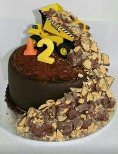 Birthday cake idea for Blake. Will do a chocolate cake with chocolate frosting and use the peanut butter cups as rocks for the toy truck to be climbing over