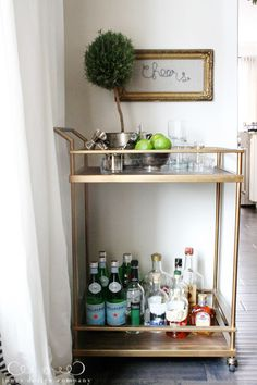 cheers art and a bar cart