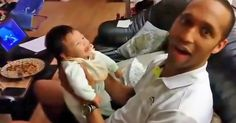 A Dad Makes His Baby Laugh For The First Time And The Pair Fall Into A Fit Of Giggles.