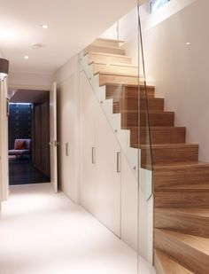 Basement remodeling can add lots of extra living space to your home but beware; Staircase Storage, Staircase Design, Open Staircase, Basement Storage, Under Stair Storage, Organized Basement, Spiral Staircases, Staircase Ideas, Attic Storage