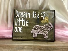 "Only $15! Fun sign for nursery! ""Dream big little one"" will be the perfect touch for your baby's nursery.  Think kids are terrible or just don't need one for yourself? Then this would make a perfect baby shower gift!"