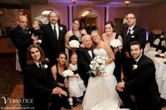 The newlyweds celebrate in the Versailles Ballroom, Toms River with all their friends and family. www.VersaillesCaterers.com. Photo courtesy of John O'Boyle Photography.  #NJWeddings #WeddingsNearTomsRiver #VersaillesBallroom #WeddingsNearJerseyShore #Bride #Groom #Weddings #CentralNJWeddingVenue #NJWeddingVenue #WeddingPhotography #NJBanquetHall #NJWeddingVenue #Ramada #JerseyShoreWeddings