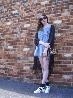 OOTD/ street style featuring an acid washed denim dress, black fringe kimono, black lace socks, JuJu jelly sandals, bold sunglasses, red lipstick and a leopard print crossbody bag