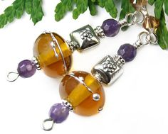 #Amber #lampwork glass and #amethyst gemstone beads come together in a lovely stylish pair of sterling silver handmade dangle #earrings. By #PrettyGonzo #Jewelry