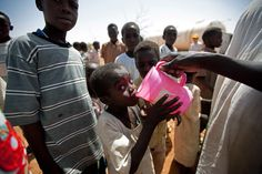 World Water Day 2012: A child drinks water in el-Srief, North Darfur, on July 25, 2011, as some 40,000 liters of water is distributed as part of a DDR (Disarmament, Demobilization and Reintegration) outreach activity, organized by the United Nations-African Union Mission in Darfur among the local community. The nearest water point is 15 kilometers away. (Albert Gonzalez Farran/AFP/Getty Images)