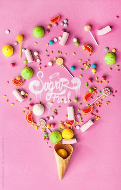 "Different candies on pink background with ""Sugar fun!"" text."