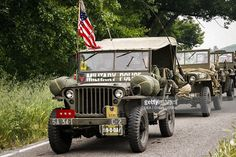 Column of Willys MB U.S. Army jeeps near the Gothic Line, Italy. Second World War, 20th century. Historical reenactment.