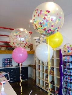"Large 3ft Diamond Clear balloons filled with confetti and accompanied by bright round 17"" balloons to create a statement: Fun Times to be had at this party!"