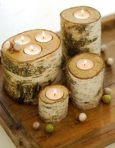 Velas incrustadas en troncos de madera Más