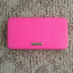 Neon wallet Bright pink wallet. The button is easy to press to open the wallet. No flaws. Used once Kenneth Cole Reaction Bags Wallets