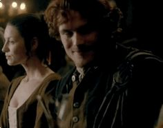 Claire & Jamie leaving Laoghaire in the Great Hall .gif