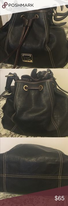 Dooney and Bourke Drawstring Purse Chocolate pebble grain leather handbag. Some signs of wear on the inside. Dooney & Bourke Bags Shoulder Bags