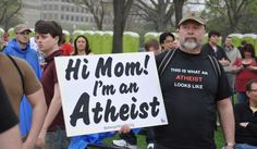 To tackle the stigma of being an atheist in the US, a controversial billboard campaign is urging non-believers to 'come out' about their views.