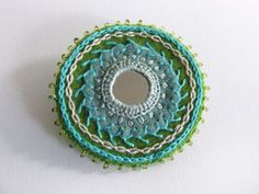 Turquoise and green shisha brooch Hand Embroidery Dress, Folk Embroidery, Indian Embroidery, Free Machine Embroidery, Hand Embroidery Designs, Beaded Embroidery, Embroidery Stitches, Embroidery Ideas, Heart Mirror