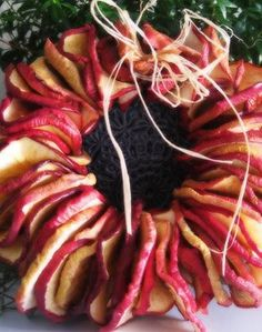 "ApPLe wReAtH~ I love making these. I 1st slice 1/4"" slices, then poke a very small hole in the middle of the slices big enough for the thread/ribbon to go through. Then Dip apple slices in vanilla extract, then dip slices in mixture of apple pie spice mix (or use pumpkin pie spice mix). To the pie spice I add: a little ground cinnamon and a just a teenie tiny sprinkle of clove. place in lowest setting oven- mine is at 120F, for 2 hrs, turn over and bake another 2-3 hrs, till thoroughly dry."