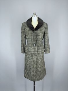 Gorgeous vintage 1960s wool suit by Adolph Blank. Black, grey and white tweed with a very dark, almost black, fur collar. Jacket has a button front