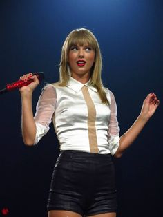 Saw Taylor in the Red Tour twice! It is so cute when she does this with her eyes(: the crowd goes crazy!!