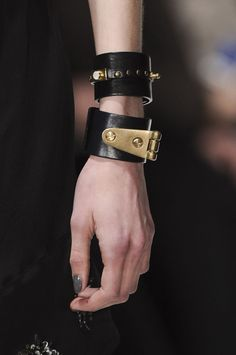 Arm Candy... statement cuffs with brass screws and fittings; black & gold jewellery