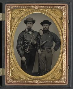 (c. 1861-1865) Two soldiers in Mississippi battle shirts with double barrel shotguns, knives, and powder horns