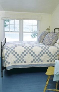 "Love the Double Irish Chain quilt in this ""Bluetiful"" primitive bedroom. Love the painted floor also and yellow chair."