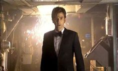 Rickston Slade: Hang on a minute. Who put you in charge? And  who in the hell are you anyway? The Doctor: I'm the Doctor. I'm a Time Lord. I'm from the  planet Gallifrey in the constellation of Kasterborous. I'm 903 years  old, and I'm the man who's gonna save your lives and all six billion  people on the planet below. You got a problem with that?/Slade: No./The Doctor: In that case:...Allons-y!