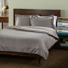 A satiny soft duvet cover set brings comfort to your bedroom. This 600-thread-count duvet set resists wrinkles and comes in all bed sizes, as well as six different solid colors. The duvet has button closures and is machine-washable for easy care.