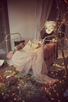 Magical princess, or fairy bed. Fairy lights, tulle, metal bed frame, woodland.  Beautiful styling and props for display